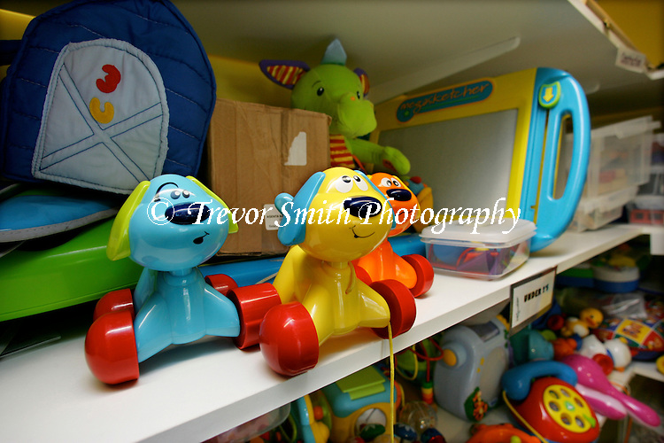 Children's Toys on a shelf in a Toy Cupboard