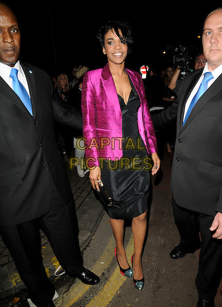 MICHELLE WILLIAMS (ex Destiny's Child).At the Vivienne Westwood Show, London Fashion Week Day 3, The Old Sorting Office, London, England, UK,.September 20th 2009..full length pink silk purple jacket black dress silver toe cap two tone shoes red clutch bag security minders .CAP/CAN.©Can Nguyen/Capital Pictures.