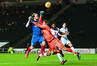 Kieran Agard of MK Dons is taken out by Goalkeeper of Peterborough Johnathan Bond during the Sky Bet League 1 match between MK Dons and Peterborough at stadium:mk, Milton Keynes, England on 30 December 2017. Photo by Bradley Collyer / PRiME Media Images.