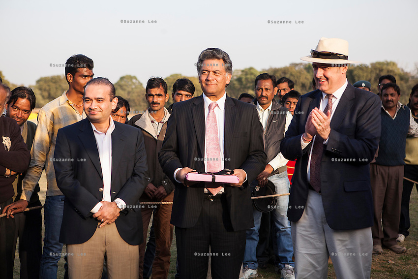 (L-R) Nirav Modi, Nik Senapati and Dr Lachlan Strahan prepare to present gifts to both the Royal Jaipur Polo Team and the Western Australia Polo Team after a close match for the Argyle Pink Diamond Cup, organised as part of the 2013 Oz Fest in the Rajasthan Polo Club grounds in Jaipur, Rajasthan, India on 10th January 2013. Photo by Suzanne Lee