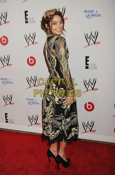 Vanessa Hudgens<br /> WWE &amp; E! Entertainment's &quot;SuperStars For Hope&quot; supporting Make-A-Wish at The Beverly Hills Hotel in Beverly Hills, CA., USA.<br /> August 15th, 2013<br /> full length gold black embroidered hair up braid plait dyed blonde dress side looking over shoulder <br /> CAP/ROT/TM<br /> &copy;Tony Michaels/Roth Stock/Capital Pictures