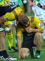 Brad Shields checks on Dane Coles during the Super Rugby match between the Hurricanes and Highlanders at Westpac Stadium in Wellington, New Zealand on Saturday, 4 March 2017. Photo: Dave Lintott / lintottphoto.co.nz
