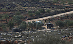 Palestinians throw stones at Israeli soldiers during clashes after confrontations with Israeli settlers in the village of Qusra, near the West Bank City of Nablus, 30 November 2017. According to reports, the Palestinian villagers briefly detained a group of Israeli settlers, after the settlers allegedly killed a Palestinain farmer in his field in the West Bank village of Qusra. After a short period of time the Israeli troops arrived and removed the detained settlers. Photo by Ayman Ameen