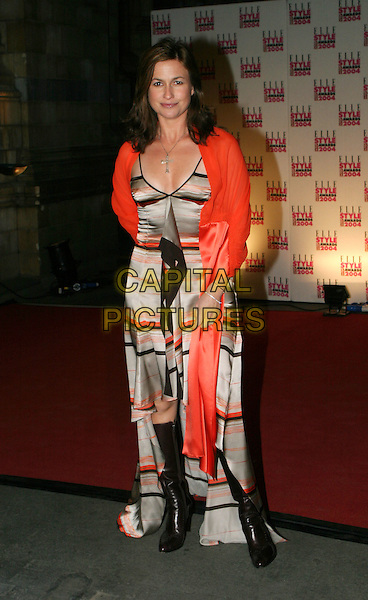 EMMA FORBES.Elle Style Awards 2004 at the Natural History Museum.16 February 2004.full length, full-length, bold print dress, red shawl wrap pashmina, knee high boots.www.capitalpictures.com.sales@capitalpictures.com.© Capital Pictures.