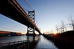 The sun rises over the Delaware River under the Benjamin Franklin Bridge in Philadelphia, Pennsylvania on January 18th 2012. (Photo By Brian Garfinkel)