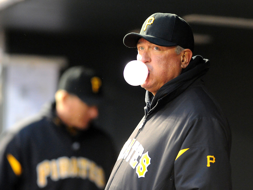 30 APRIL 2011: Pittsburgh Pirates manager Clint Hurdle (13) blows a bubble gum bubble during a regular season game between the Pittsburgh Pirates and the Colorado Rockies at Coors Field in Denver, Colorado. The Rockies beat the Pirates 4-1. *****For Editorial Use Only*****