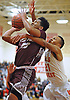 Darien Jenkins #20 of Deer Park, left, draws a foul on Jovahn Williamson #21 of Half Hollow Hills West during a Suffolk County varsity boys basketball game at Half Hollow Hills West High School on Thursday, Jan. 19, 2017. Deer Park won by a score of 59-49.