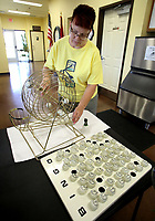 NWA Democrat-Gazette/DAVID GOTTSCHALK   Penny Blickenstaff rotates the cage before pulling  bingo balls to call Wednesday, July 12, 2017, during a game of blackout bingo at the Lowell Senior Activity Center. Bingo is played every Wednesday beginning at 9:15 a.m.. The center offers a variety of activities including Beanbag Baseball, Chair Yoga and musical entertainment.