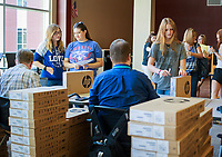 NWA Democrat-Gazette/CHARLIE KAIJO Ishe Shearer, 14, of Bentonville and Heather Wise (from left) and Aubry Townzen, 14, of Bentonville pick up school issued Chromebooks during an open house, Thursday, August 1, 2018 at Bentonville High School in Bentonville. <br />