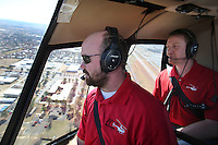 NWA Democrat-Gazette/DAVID GOTTSCHALK   Camron McAhren (right), operations director at Arkansas Helicopters of Springdale, rides with Kyle Flynn, pilot, Tuesday, February 7, 2017, as they bank over the Springdale Municipal Airport in a Robinson 44 Raven 2. For the third year, the company is offering Valentine's Day flights.