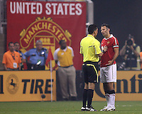 Ryan Giggs #11 of Manchester United talks to referee Jorge Gonzalez during the 2010 MLS All-Star match against the MLS All-Stars at Reliant Stadium, on July 28 2010, in Houston, Texas. Manchester United won 5-2.