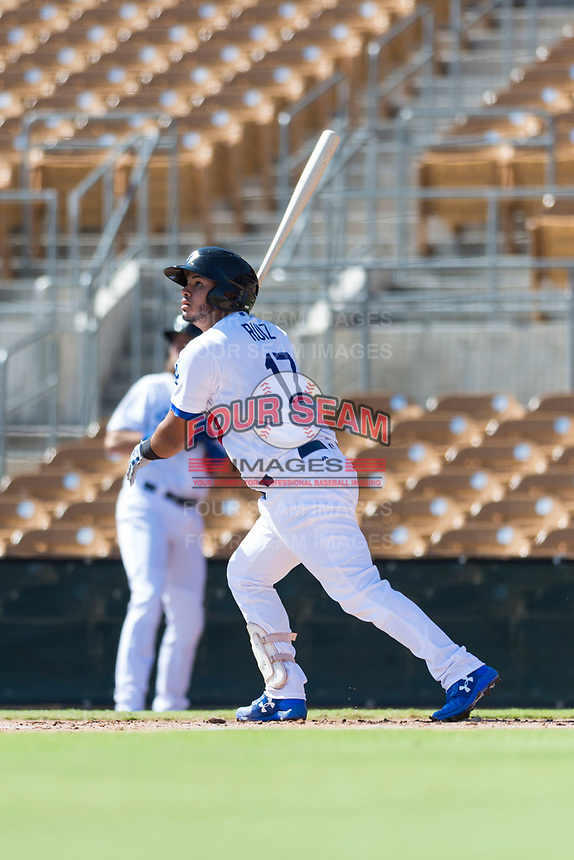 Glendale Desert Dogs catcher Keibert Ruiz (17), of the Los Angeles Dodgers organization, follows through on his swing during an Arizona Fall League game against the Mesa Solar Sox at Camelback Ranch on October 15, 2018 in Glendale, Arizona. Mesa defeated Glendale 8-0. (Zachary Lucy/Four Seam Images)