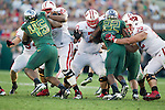 Wisconsin Badgers offensive linemen Josh Oglesby (67), Kevin Zeitler (70) and Travis Frederick (72) block during the 2012 Rose Bowl NCAA football game against the Oregon Ducks in Pasadena, California on January 2, 2012. The Ducks won 45-38. (Photo by David Stluka)
