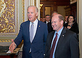 United States Vice President Joe Biden, left, departs the US Senate Chamber in the US Capitol in Washington, DC with US Senator Chris Coons (Democrat of Delaware), right, after being honored with a series of bipartisan tributes on the Senate floor on Wednesday, December 7, 2016.<br /> Credit: Ron Sachs / CNP
