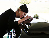 In this hand-out photo released by the McCain family, Cindy McCain lays her head on the casket of Sen. John McCain, R-Ariz., during a burial service at the cemetery at the United States Naval Academy in Annapolis, Md., on Sunday, Sept. 2, 2018. <br /> Credit: David Hume Kennerly / McCain Family via CNP