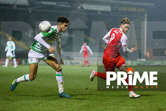 Wes Burns of Fleetwood Town flicks the ball past Omar Sowunmi of Yeovil during the Checkatrade Trophy match between Yeovil Town and Fleetwood Town at Huish Park, Yeovil, England on 6 February 2018. Photo by Mark Hawkins.