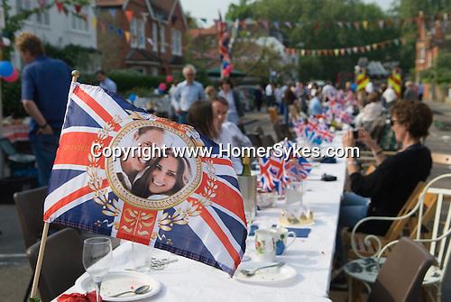 Royal Wedding Street Party. Barnes London. Prince William and Catherine souvenire Union Jack Flag. April 29 2011.