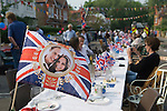 Royal Wedding Street Party. Barnes London. Prince William and Catherine souvenire Union Jack Flag. April 29 2011.