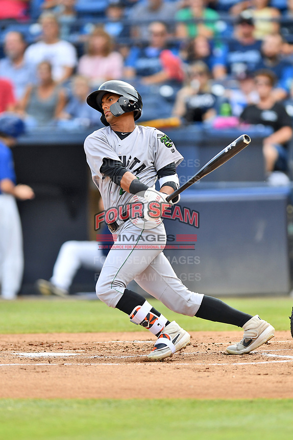 Augusta GreenJackets Jose Layer (22) swings at a pitch during a game against the Asheville Tourists at McCormick Field on July 13, 2019 in Asheville, North Carolina. The GreenJackets defeated the Tourists 6-4. (Tony Farlow/Four Seam Images)