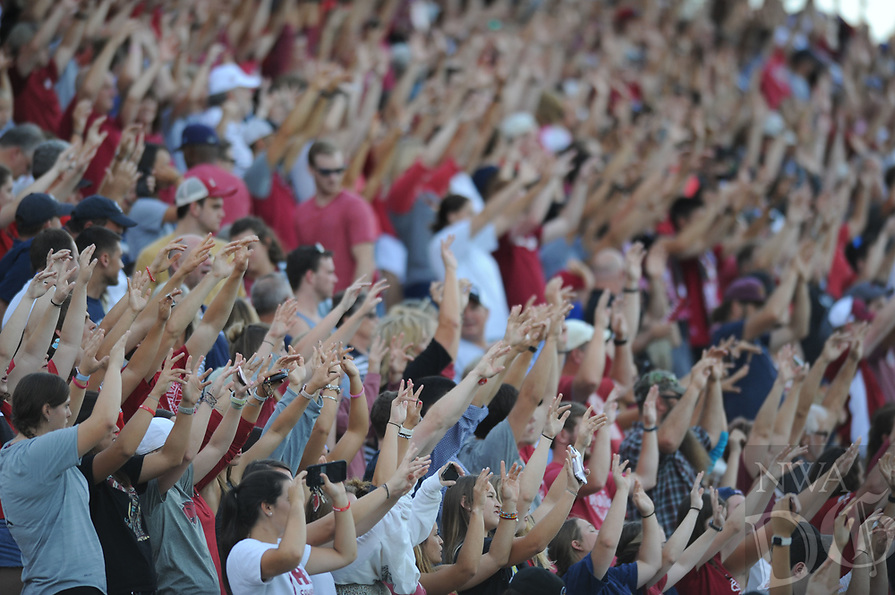 NWA Democrat-Gazette/ANDY SHUPE<br /> Arkansas fans call the Hogs against top-ranked Penn State Friday, Aug. 25, 2017, during the Razorbacks' 4-2 loss at Razorback Field in Fayetteville. Visit nwadg.com/photos to see more photographs from the match.