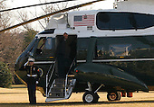 Washington, DC - February 7, 2009 -- United States President Barack Obama waves from the door of Marine One as he and his family  travel to Camp David for the first time. .Credit: Dennis Brack / Pool via CNP
