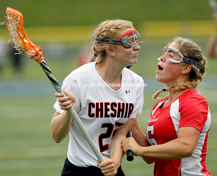 Stratford, CT-09 June 2012-060912CM06- Cheshire's Christy Myjak (left) goes head to head with Greenich's Molli Haimeri during the girls lacrosse Class L finals Saturday morning at Bunnell High School in Stratford.  Greenwich won the Class L title, after upsetting number one ranked Cheshire, 9-8.   Christopher Massa Republican-American