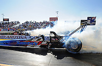 Feb. 17 2012; Chandler, AZ, USA; NHRA top fuel dragster driver Cory McClenathan (near lane) does a burnout alongside Terry McMillen during qualifying for the Arizona Nationals at Firebird International Raceway. Mandatory Credit: Mark J. Rebilas-
