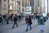 Protesters calling on Chicago Mayor Rahm Emanuel to resign march down Clark Street in the Loop in Chicago, Illinois on December 9, 2015.  Emanuel offered a historic apology for the police killing of Laquan McDonald and police brutality and racial profiling generally -- without using those words -- in front of the City Council in the morning.