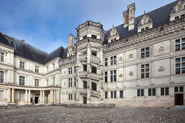 South East facade of the Francois I wing, built 16th century in Italian Renaissance style, with its monumental spiral staircase, seen from the courtyard of the Chateau Royal de Blois, built 13th - 17th century in Blois in the Loire Valley, Loir-et-Cher, Centre, France. On the left is the Gaston d'Orleans wing, 17th century, designed by Francois Mansart, 1598-1666. The chateau has 564 rooms and 75 staircases and is listed as a historic monument and UNESCO World Heritage Site. Picture by Manuel Cohen