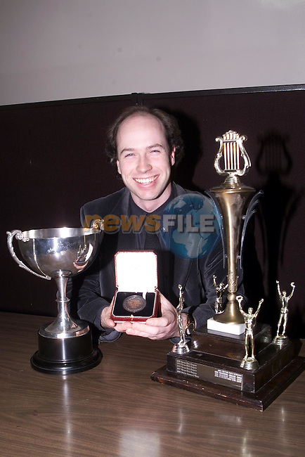 Edward Holly with the Alan Dyas Memorial Trophy, The John Short Perpetual Memorial Cup and the Micheal Van Dessel Memorial Medal for best peformance by a conductor which St. Peter's Male Voice Choir won at the Dundalk Choral Festival..Picture Paul Mohan Newsfile