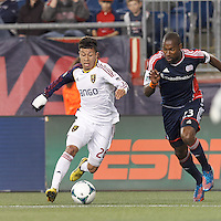 Real Salt Lake substitute midfielder Sebastian Velasquez (26) on the attack as New England Revolution defender Jose Goncalves (23) defends.