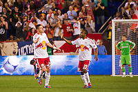Kenny Cooper (33) of the New York Red Bulls celebrates with Dane Richards (19) after scoring during the second half. The New York Red Bulls and CD Chivas USA played to a 1-1 tie during a Major League Soccer (MLS) match at Red Bull Arena in Harrison, NJ, on May 23, 2012.