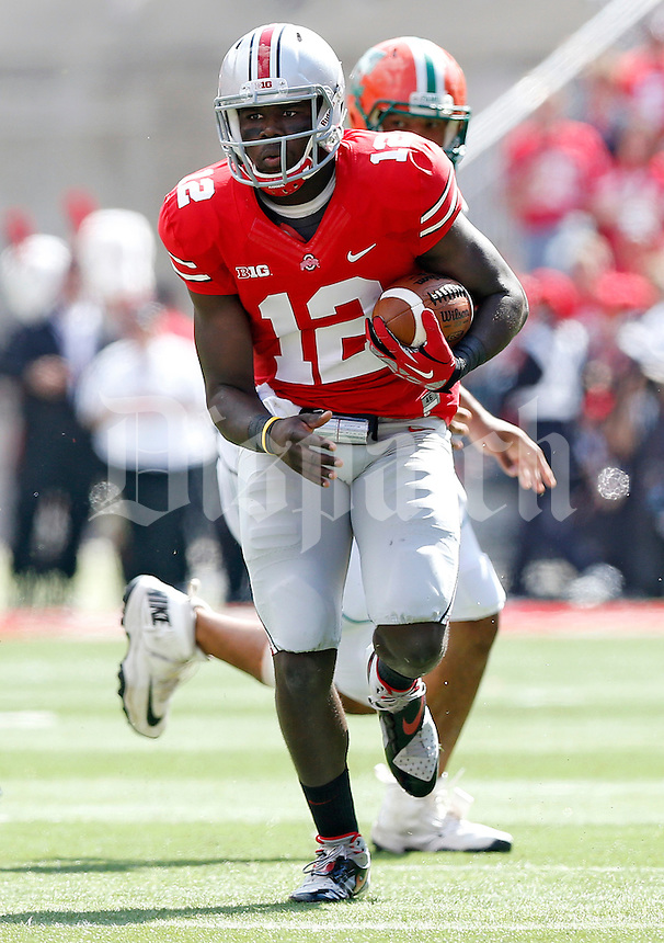 Ohio State Buckeyes quarterback Cardale Jones (12) carries the ball up field against Florida A&M Rattlers in the 3rd quarter during their college football game at Ohio Stadium on September 21, 2013.  (Dispatch photo by Kyle Robertson)