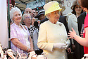 Britain's Queen Elizabeth II and the Duke of Edinburgh chat to stall holders as they tours St.Georges Market in Belfast, Tuesday June 24th, 2014. The Queen is on a 3 day tour of Northern Ireland. Photo/Paul McErlane