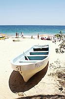 A fishig boat on the sand of Mazunte Beach, Oaxaca.