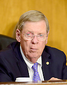 """United States Senator Johnny Isakson (Republican of Georgia) listens to testimony before the United States Senate Committee on Foreign Relations concerning """"Sanctions and the Joint Comprehensive Plan of Action (JCPOA)"""" on Capitol Hill on Wednesday, July 29, 2015.<br /> Credit: Ron Sachs / CNP"""