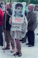 """Families of Basque prisoners hold plackards with prisoners pictures during a protest in Donostia / San Sebastian. Plackard reads in Basque language """"Gatxi, Arrasate. 8 years whithout freedom whithout rights"""".Senideak, 1999- 4- 18.Photo: Ander Gillenea"""