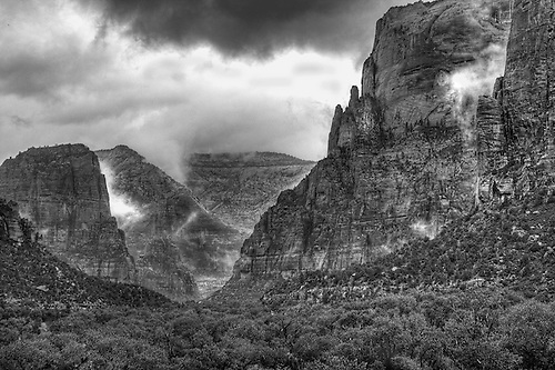 Rain and fog have enveloped Zion Canyon on a stormy afternoon at Zion National Park,Utah
