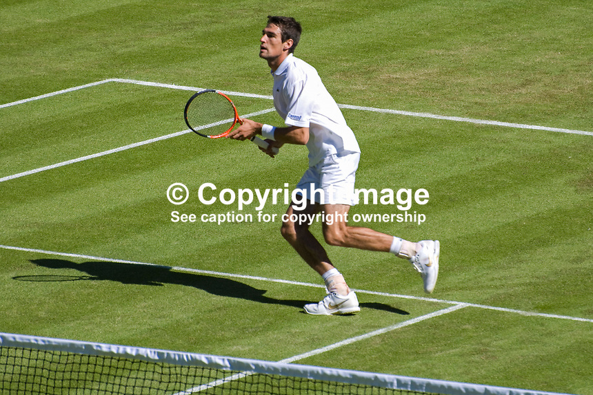 Jeremy Chardy, France, unseeded, in action against Andy Roddick, USA, seeded 6. Roddick won 6-3, 7-6, 4-6, 6-3 in this first round match of the men's singles at the Wimbledon Tennis Championships. 200906232673..Copyright Image from Victor Patterson, 54 Dorchester Park, Belfast, UK, BT9 6RJ..Tel: +44 28 9066 1296.Mob: +44 7802 353836.Voicemail +44 20 8816 7153.Skype: victorpattersonbelfast.Email: victorpatterson@mac.com.Email: victorpatterson@ireland.com (back-up)..IMPORTANT: If you wish to use this image or any other of my images please go to www.victorpatterson.com and click on the Terms & Conditions. Then contact me by email or phone with the reference number(s) of the image(s) concerned.