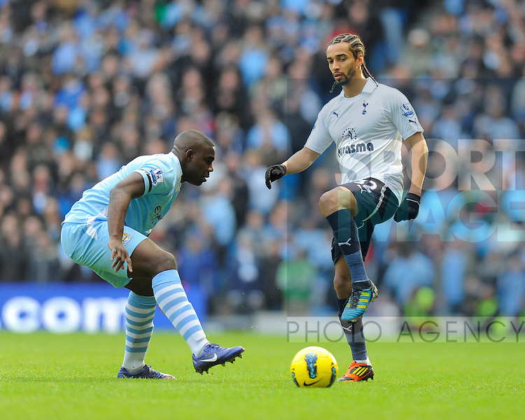 Micah Richards of Manchester City and Benoit Assou-Ekotto of Tottenham.Barclays Premier League.Manchester City v Tottenham at the Eithad Stadium, Manchester 22nd January, 2012..Sportimage +44 7980659747.picturedesk@sportimage.co.uk.http://www.sportimage.co.uk/.Editorial use only. Maximum 45 images during a match. No video emulation or promotion as 'live'. No use in games, competitions, merchandise, betting or single club/player services. No use with unofficial audio, video, data, fixtures or club/league logos.