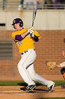 Jared Avchen #22 of the East Carolina Pirates follows through on his swing versus the Virginia Cavaliers at Clark-LeClair Stadium on February 20, 2010 in Greenville, North Carolina.   Photo by Brian Westerholt / Four Seam Images