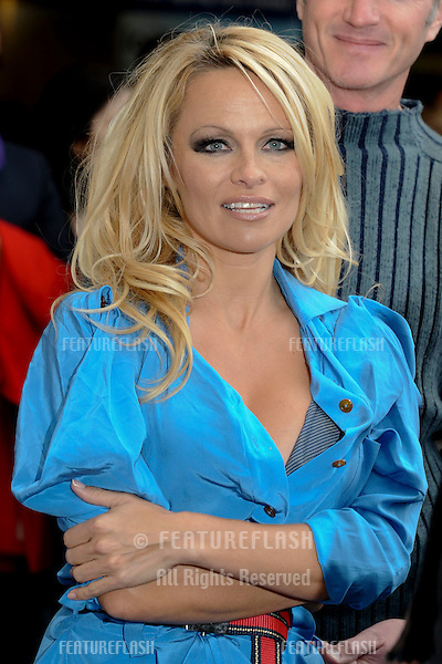 Pamela Anderson unveils her new poster for PETA in Covent Garden, London. 24/10/2010  Picture by: Steve Vas / Featureflash