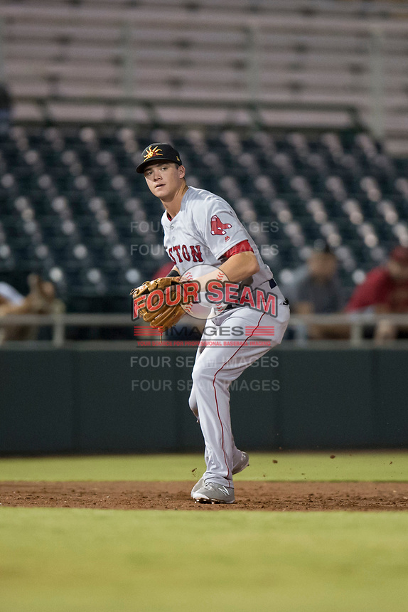 Mesa Solar Sox third baseman Bobby Dalbec (11), of the Boston Red Sox organization, prepares to make a throw to first base during an Arizona Fall League game against the Scottsdale Scorpions on October 9, 2018 at Scottsdale Stadium in Scottsdale, Arizona. The Solar Sox defeated the Scorpions 4-3. (Zachary Lucy/Four Seam Images)