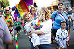 """© Joel Goodman - 07973 332324 - all rights reserved . 24/08/2019. Manchester, UK. PARKER LINDLEY (four) and his mother RACHEL LINDLEY (44) of """" Proud to be Parents """" . The 2019 Manchester Gay Pride parade through the city centre , with a Space and Science Fiction theme . Manchester's Gay Pride festival , which is the largest of its type in Europe , celebrates LGBTQ+ life . Photo credit: Joel Goodman/LNP"""