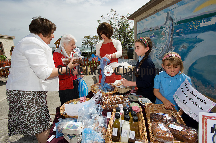 Mary Ginnane making a purchase during the annual open air market day at Carrigaholt National school. Photograph by John Kelly.
