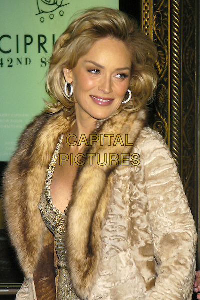 SHARON STONE.Black tie gala benefit for amfAR, the foundation for AIDS research, at Cipriani on 42nd Street, New York, New York, USA..January 31st, 2007.half length silver gold sequins sequined sequin dress beige brown fur coat lined diamond hoop earrings.CAP/ADM/BL.©Bill Lyons/AdMedia/Capital Pictures *** Local Caption ***