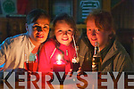 Valarie O'Callaghan, Megan O'Callaghan and Sheila Fahey enjoy a drink by candle light in the Failte bar Killarney on Wednesday after the electricity went out