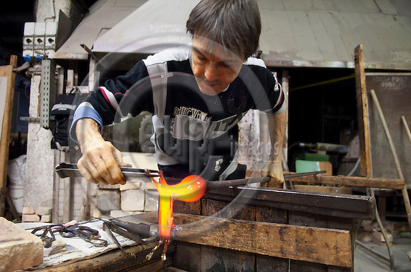 Murano-Venice-Italy, January 30, 2011 -- Demonstration by a glassblower in the workshop of a glassmaker / factory on the island -- tourism, people, art, culture -- Photo: Horst Wagner / eup-images