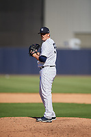 New York Yankees relief pitcher Jonathan Holder (56) gets ready to deliver a pitch during a Grapefruit League Spring Training game against the Toronto Blue Jays on February 25, 2019 at George M. Steinbrenner Field in Tampa, Florida.  Yankees defeated the Blue Jays 3-0.  (Mike Janes/Four Seam Images)