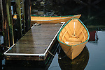 Two yellow rowboats with green trim tied to a small dock, Lunenburg Nova Scotia